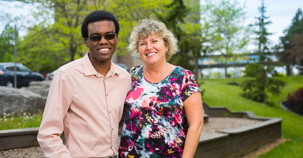 UBuffalo student Garfield Walker stands outside with EOP counselor Lani Jendrowski