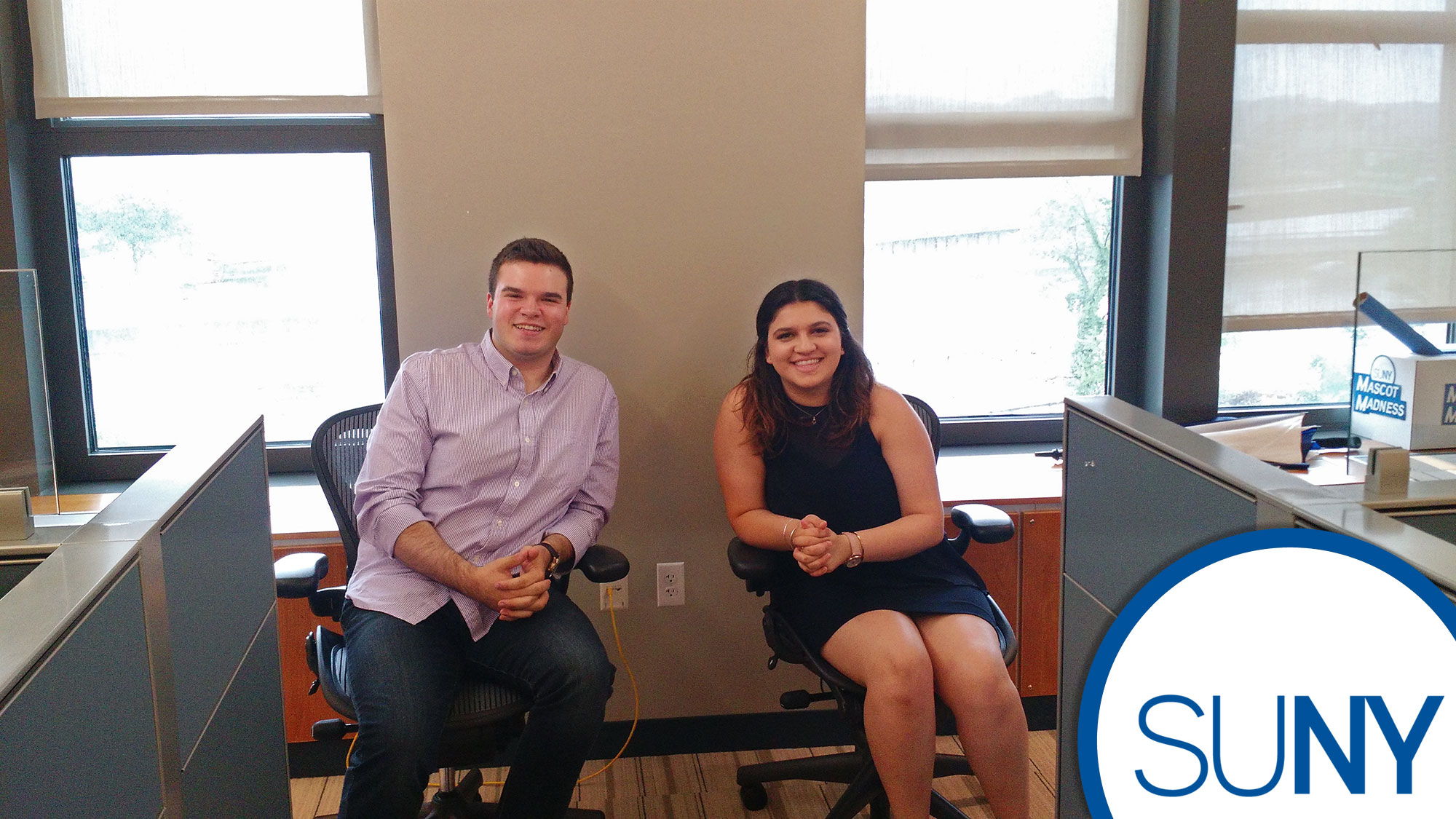 SUNY system admin interns Sarah Petrak and Nick Simons at their work stations.