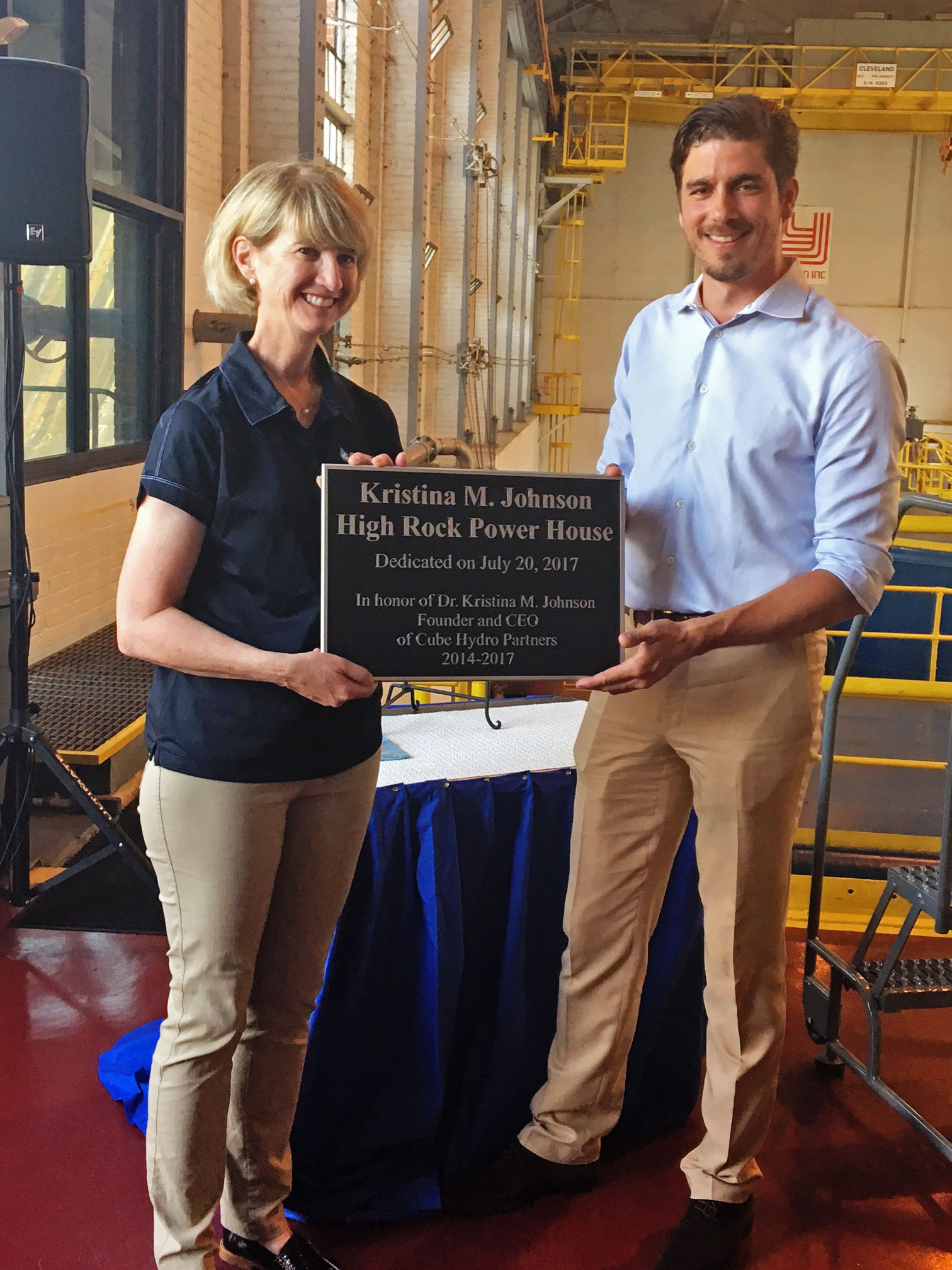 Dr. Kristina M Johnson receives a plaque commemorating the High Rock Power House to her inside the facility.