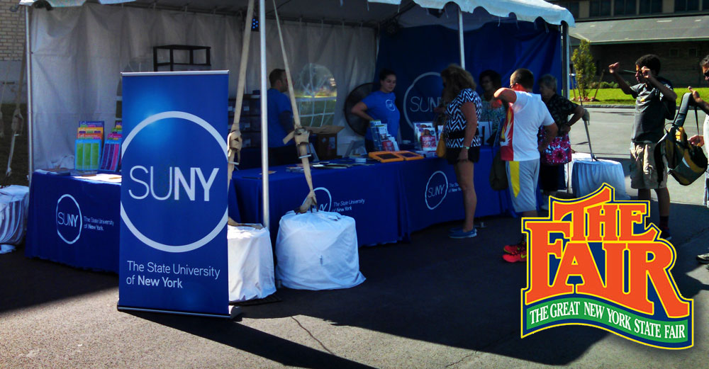SAttendees meet with SUNY Staff at the SUNY Botth at the 2016 New York State Fair.