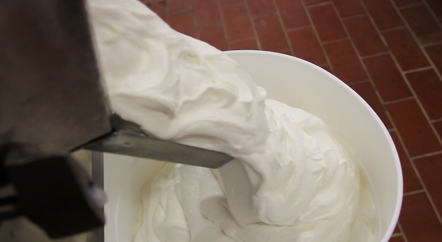 Ice cream production machine spills out vanilla ice cream at Morrisville State College.
