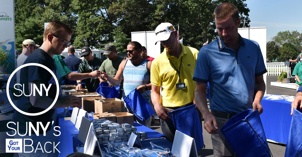 PGA Tour pros Chris Kirk and Vaughn Taylor fill comfort bags for SUNY's Got Your Bag at the 2016 Barclays Tournament at Bethpage Black.
