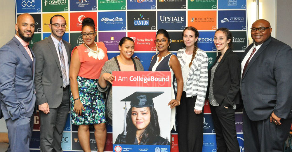 Students from the New York City area stand in front of a SUNY banner around a sign that says I Am College Bound.