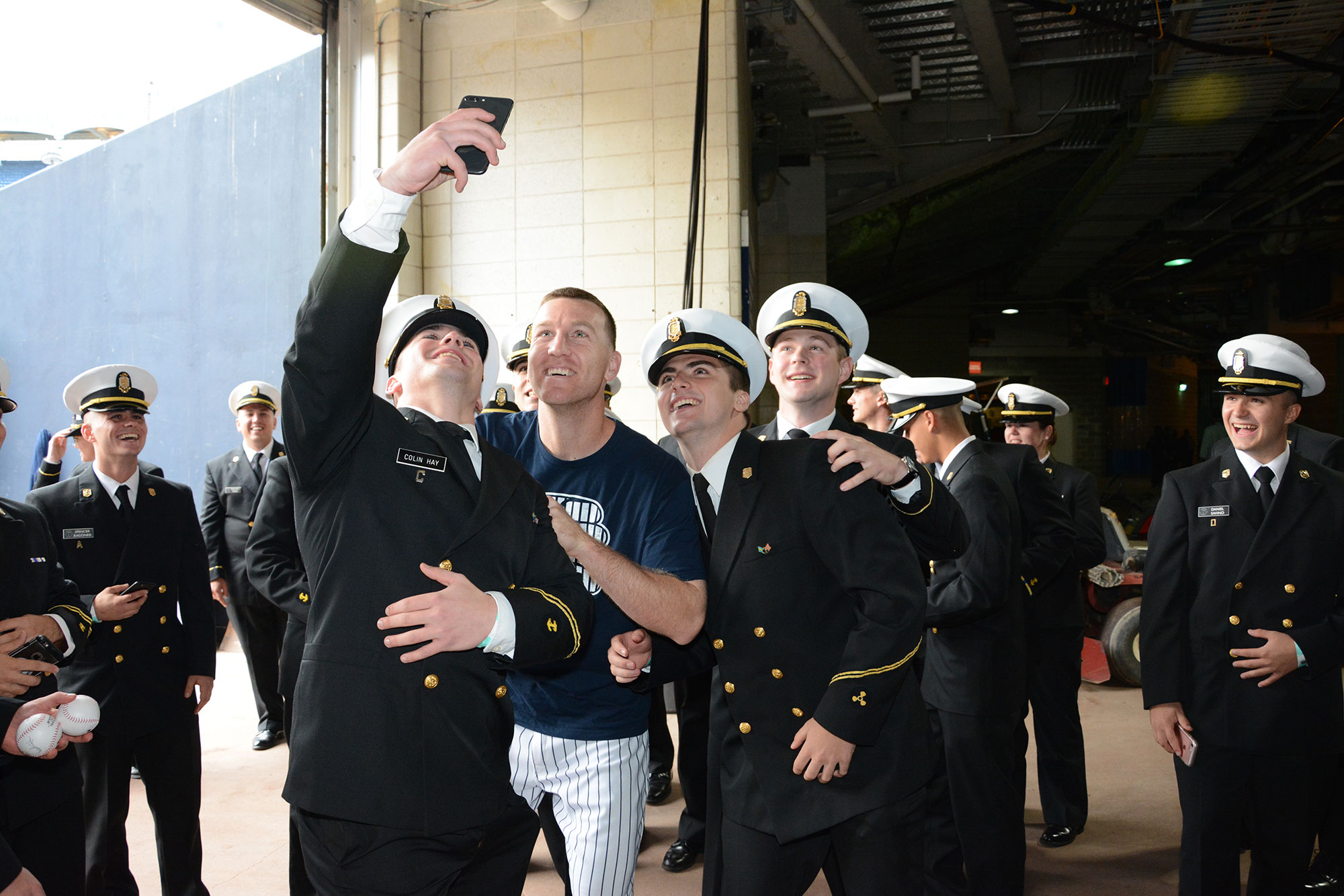 NY Yankee Todd Frazier takes a selfie with SUNY Maritime students under Yankee Stadium concourse.
