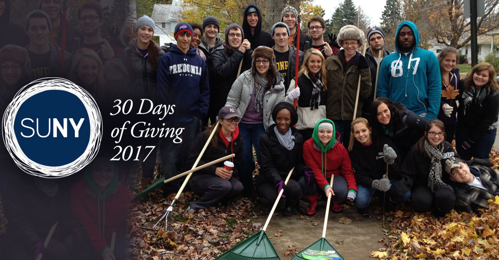 30 Days of Giving 2017 - Fredonia students pose for a picture after raking leaves in city street cleanup effort.