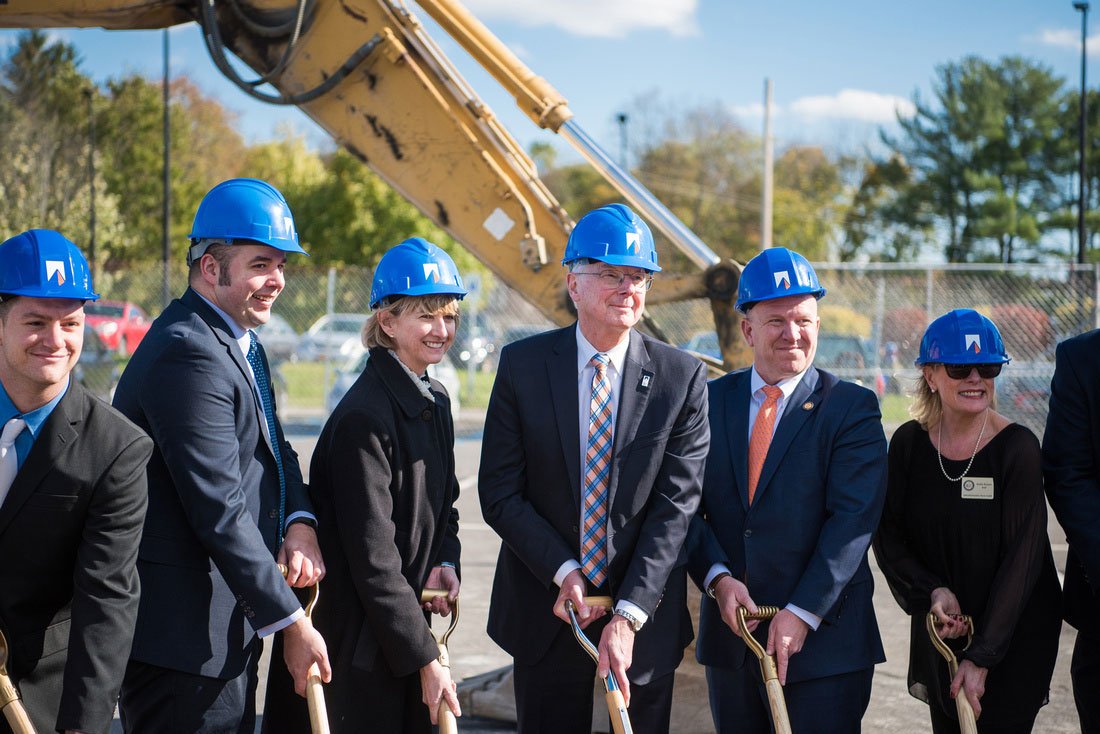 Chancellor Johnson, New Paltz president Donald Christian, and other officials pose outdoors during groundbreaking of New Paltz Engineering Hub.