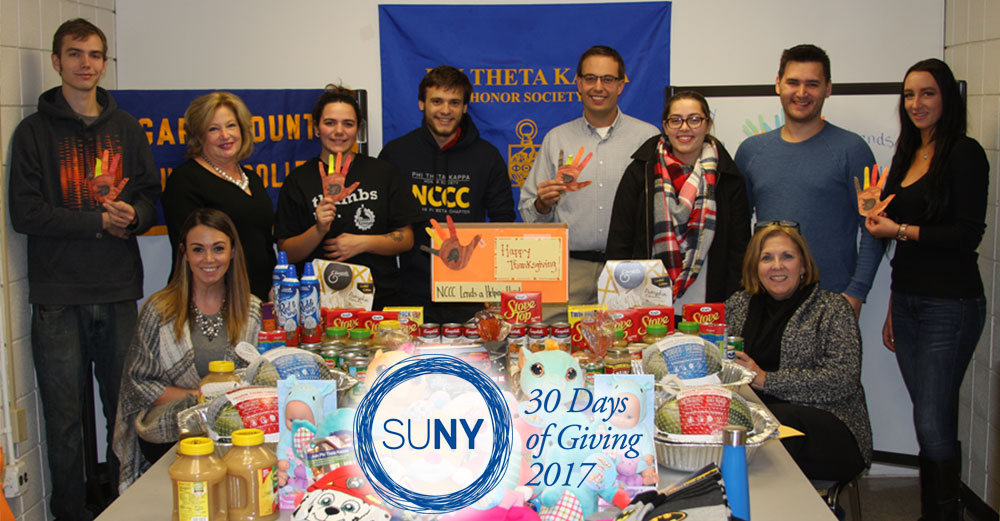 Members of the Niagara County Community College Practical Business Club and Phi Theta Kappa Honor Society and their faculty advisors put Thanksgiving baskets together.