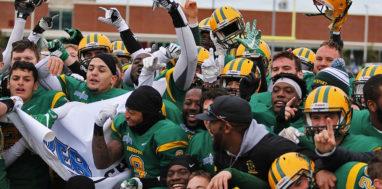 Brockport football teams celebrates a conference championship.