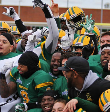Brockport football teams celebrates a conference championship.