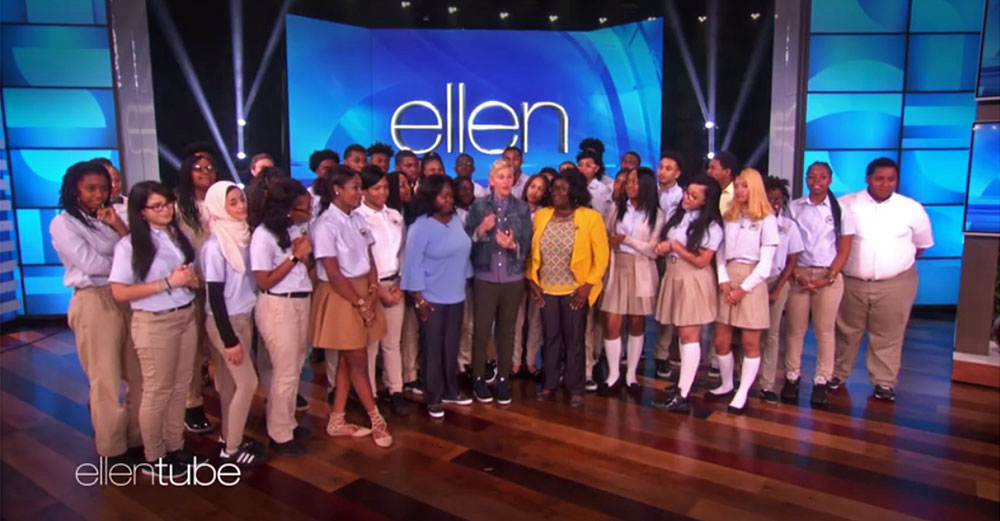 Ellen DeGeneres stands with students from Summit Academy on her set stage.