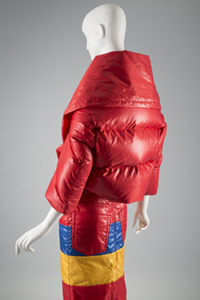 A mannequin in a red puffer coat.
