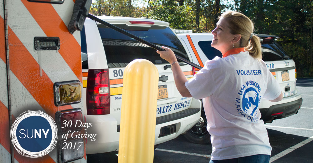 Female student from SUNY New Paltz washes an amublance at the rescue squad during Service Day.
