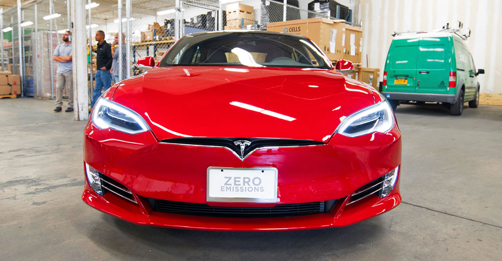 The front of a red Tesla Model S car.