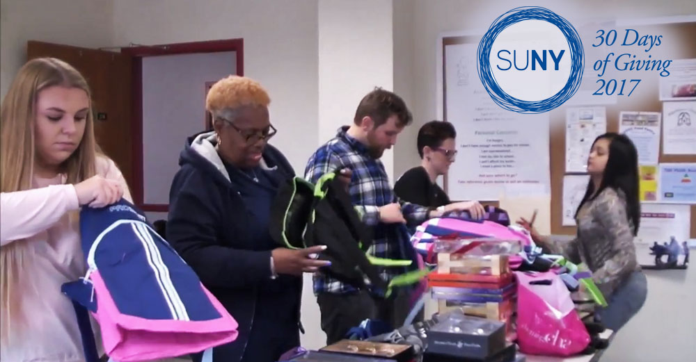 Students at Schenectady County Community College fill backpacks with gifts for children.