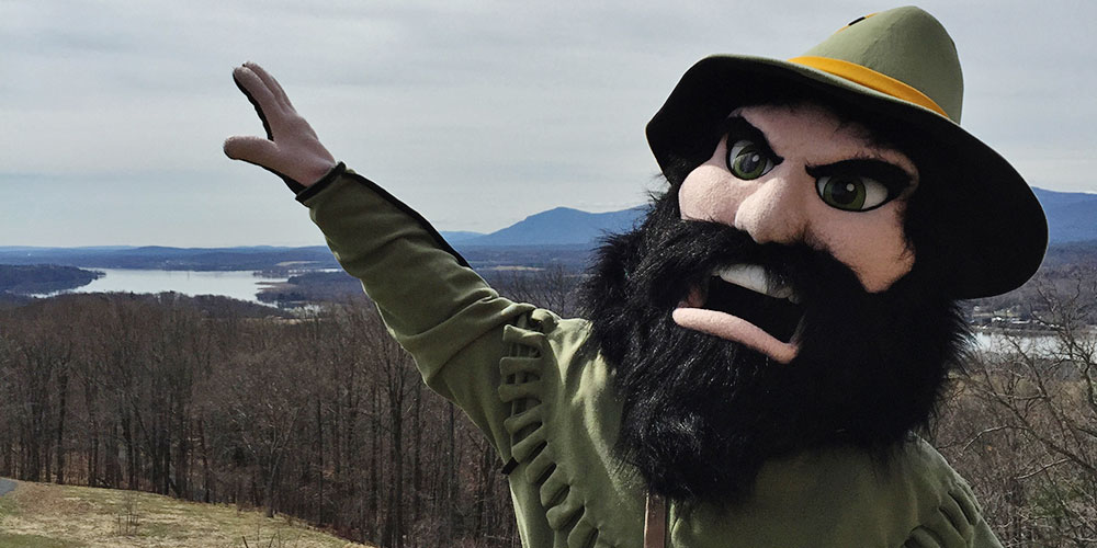 Columbia-Greene Community College mascot Rip outside on a hilltop.