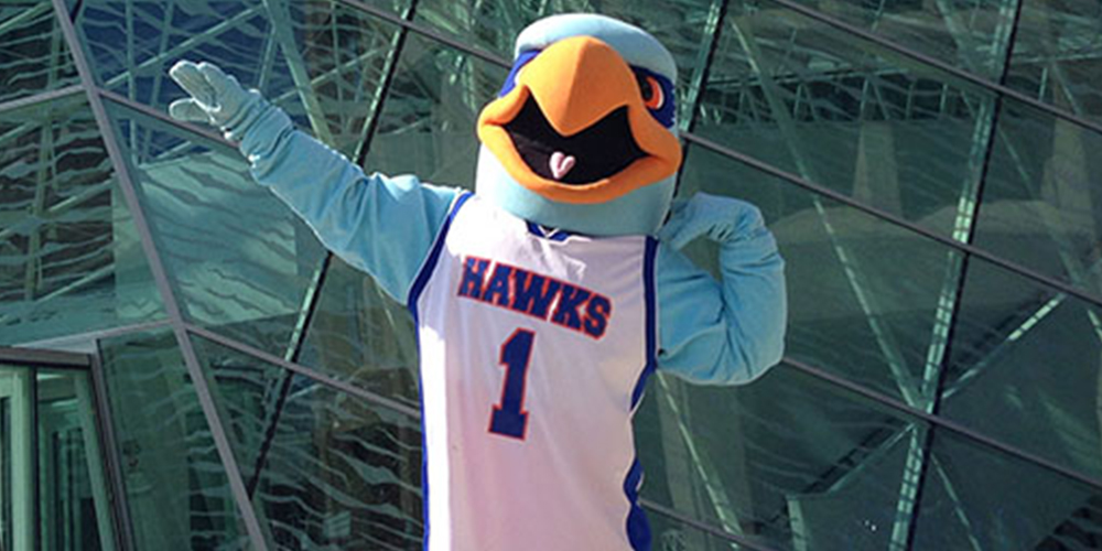 SUNY New Paltz mascot Hugo Hawk poses outside.