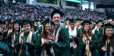 Students standing at Binghamton university commencement
