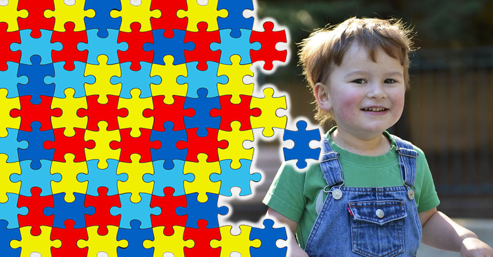 A puzzle in rainbow colors overlapping a picture of a young child to represent autism.
