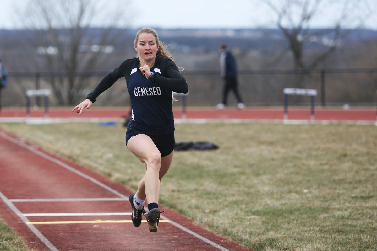 Camille Wutz of SUNY Geneseo runs in a track and field event.