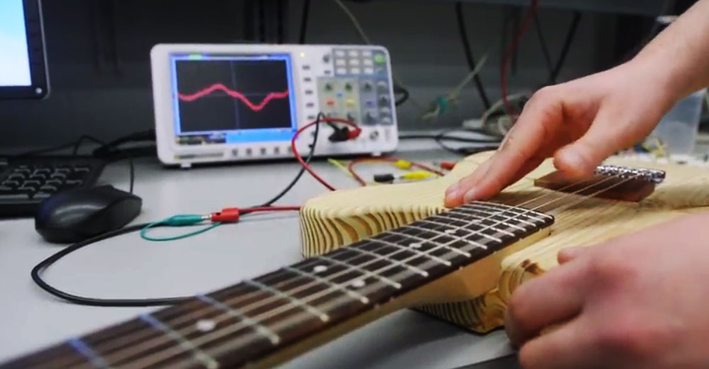 A guitar is hooked up to a computer monitor that measures sound waves for the start-up company BitCrusher.