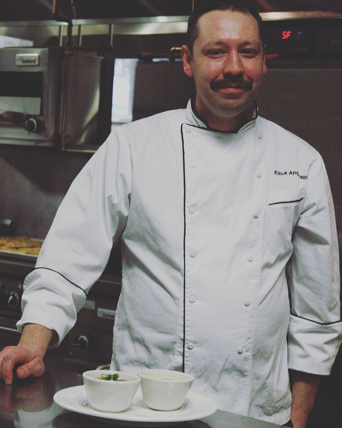 Chef Eliot Anderson of Coltivare poses in the kitchen.