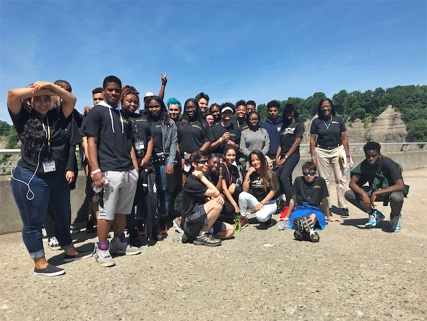 Monroe Community College EOP students pose outside in an open area of Letchworth State Park.