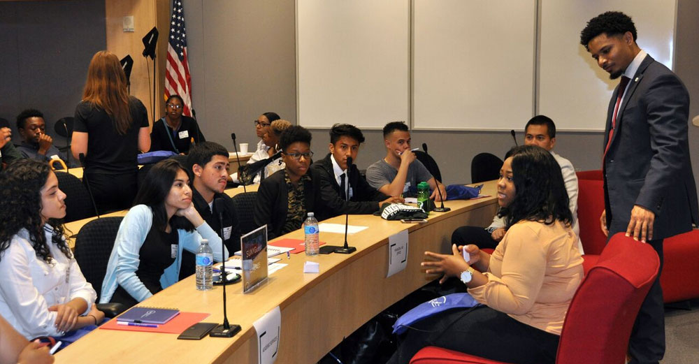 Students listen to SUNY staff at the new student sendoff event in NYC.