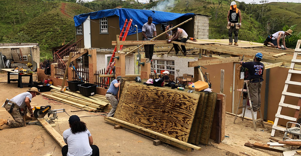 SUNY volunteers and New York tradespeople work on reconstructing a roof in Orocovis, PR about 90 minutes outside San Juan.