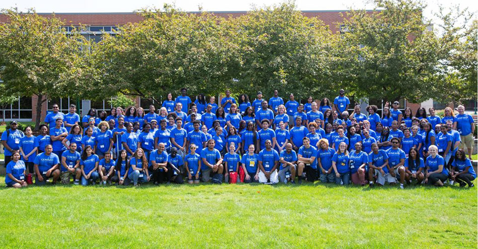 Students in a group photo outside at Camp College on the SUNY Geneseo campus.