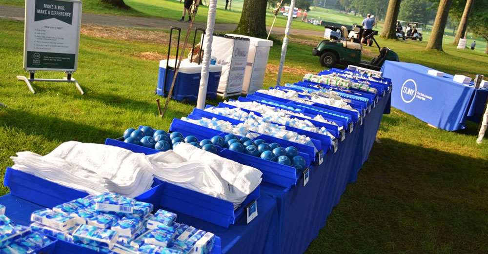 SUNY's Got Your Back goods line a table at the Dick's Sporting Goods Open in Endicott, NY.