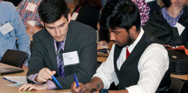 Entrepreneurs work together at a table at a SUNY ZAP event.
