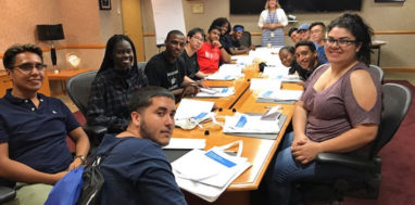 SUNY Poly EOP students pose for picture at a conference table.