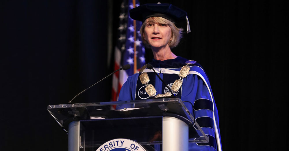 Chancellor Johnson in academic regalia speaks at her Inauguration ceremony.