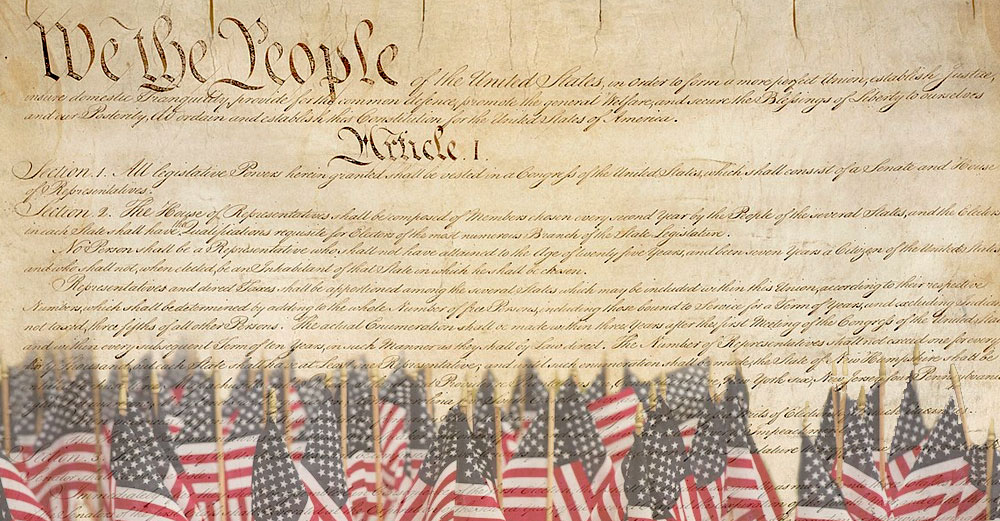 Theopening of the US Constitution, showing We The People written in large script.