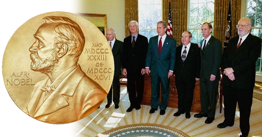 Nobel Prize medal with a picture of former winners with then-president George Bush in the oval office.