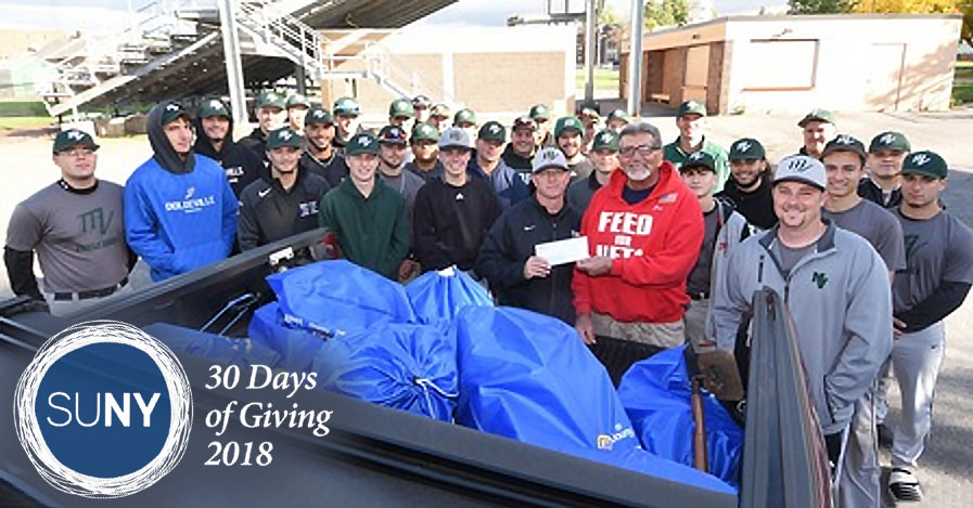 Mohawk Valley Community College baseball team members stand outside with bags of donated goods for local veterans.