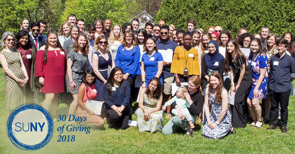 First-year interns from SUNY New Paltz pose outside with mentors.