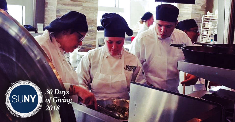 Tompkins Cortland Community College student chefs cook a meal in a restuarant kitchen.