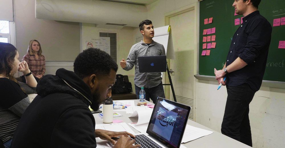 Farmingdale State students work in a classroom on the Amazon Design Challenge.