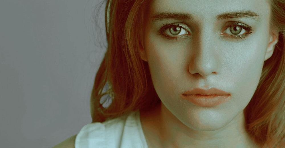 Sad girl in blue light.