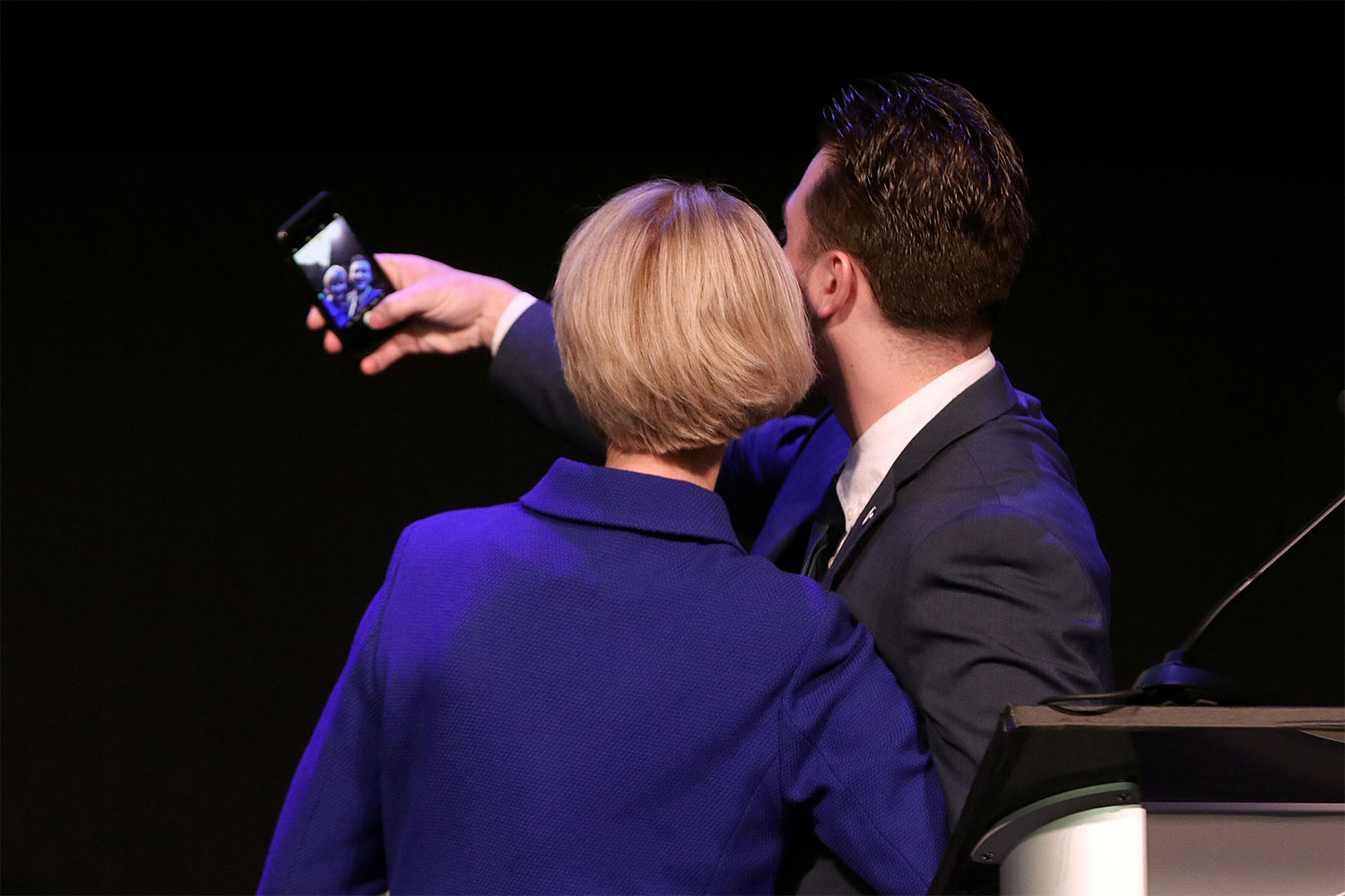 SUNY Student Assembly president Mike Braun takes a selfie with Chancellor Kristina Johnson.