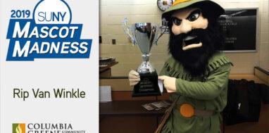 Columbia-Greene Community College mascot Rip Van Winkle with SUNY Mascot Madness trophy
