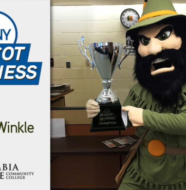 Columbia-Greene Community College mascot Rip Van Winkle with SUNY Mascot Madness trophy