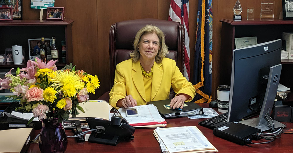 NY State Senator Shelley Mayer at her desk.