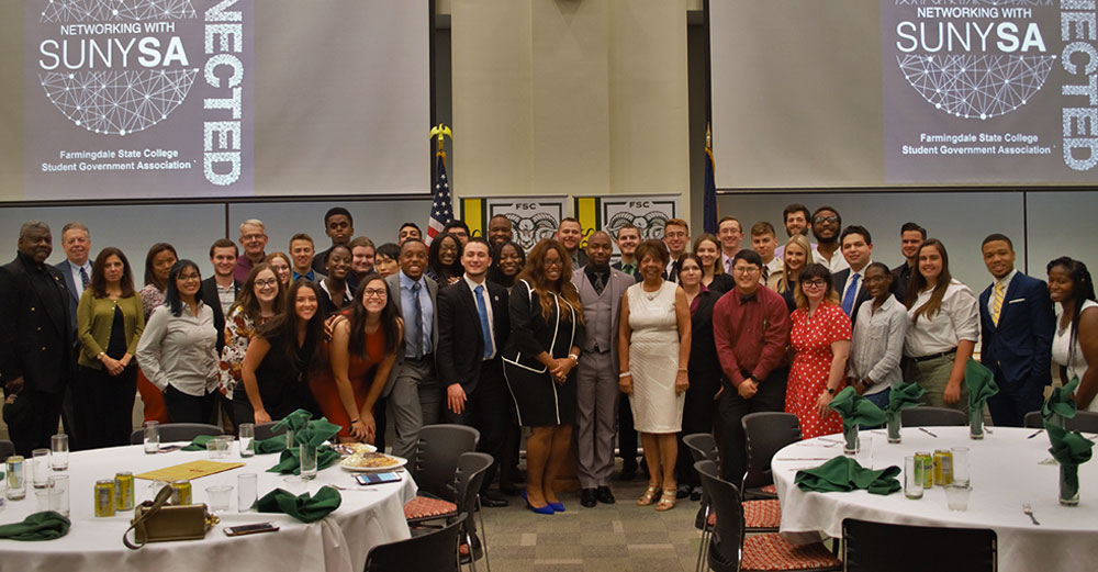 Assemblywoman Kimberly Jean Pierre poses with a large number of SUNY Student Assembly members at Farmingdale State College.