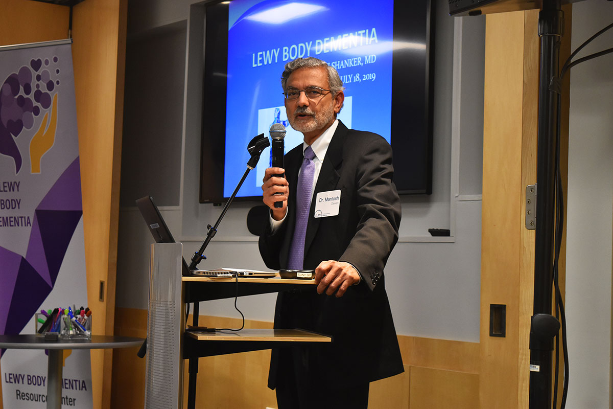Dr. Mantosh Dewan, interim president of SUNY Upstate Medical University, speaks at the Lew Body Dementia research symposium at the SUNY Global Center.