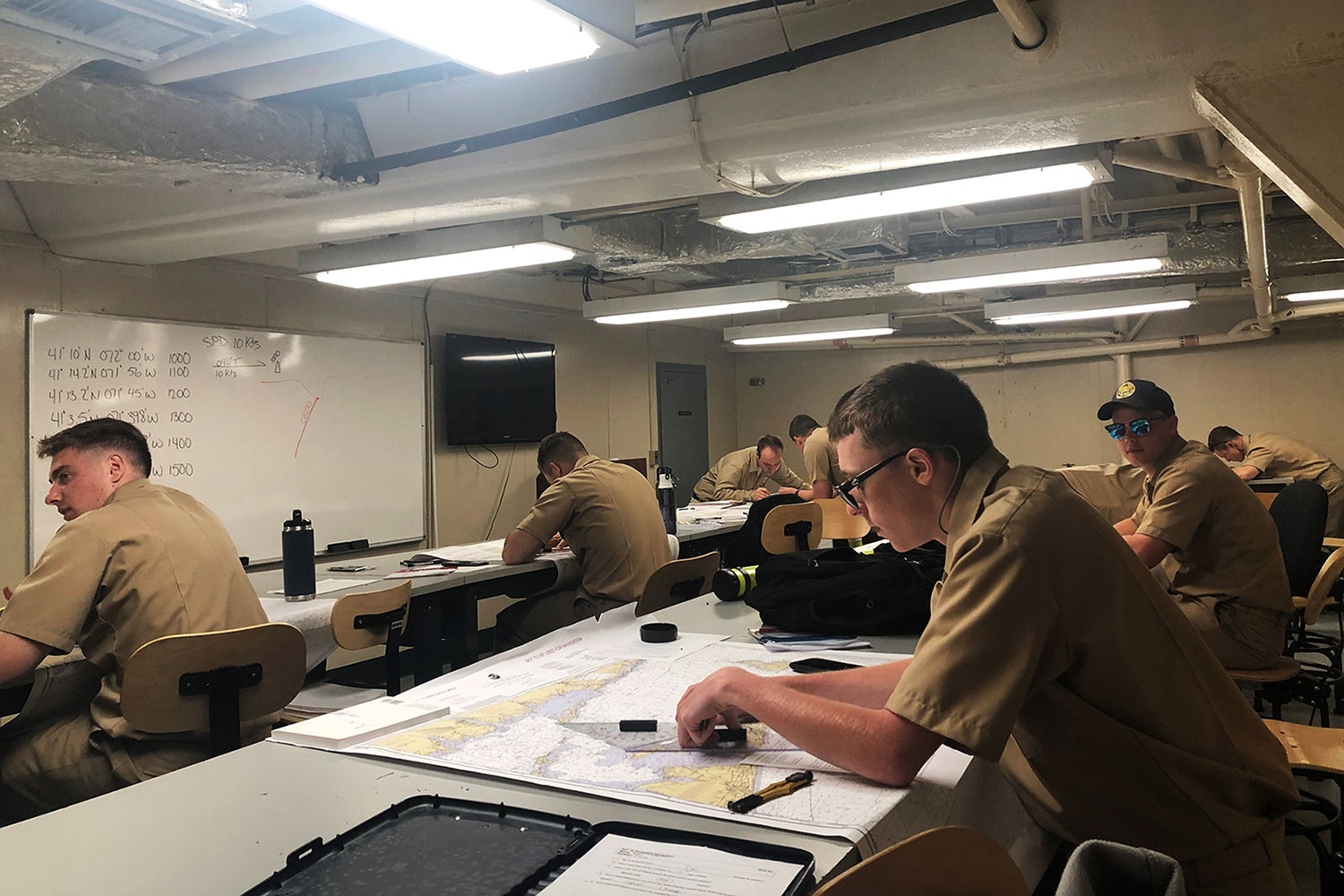 SUNY Maritime College cadets take class while aboard the Empire State VI training ship.
