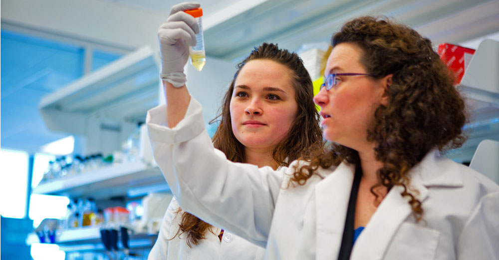 Two female students in UBuffalo medical research lab.