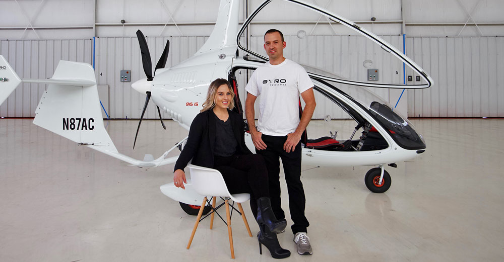 Kristen Steinhardt and Robert Lutz in a warehouse in front of a gyroplane.