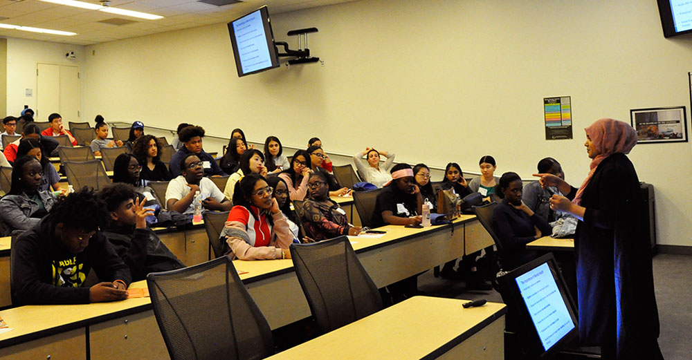 New incoming SUNY students sit in a classroom at SUNY Global Center to learn about the college experience.